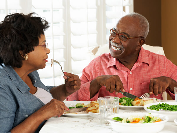 Senior Couple Enjoying Meal At Home